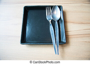Empty dish and spoon fork