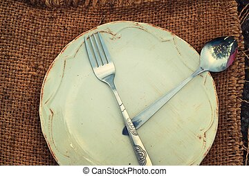 Empty dish and spoon fork.