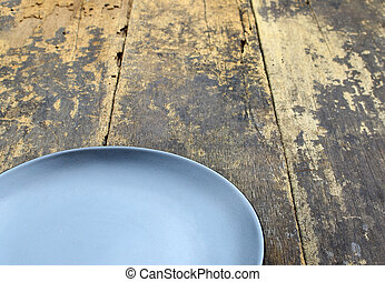 Empty dish plate on wooden background