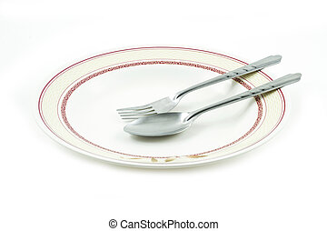 Empty dish spoon and fork