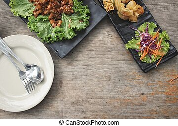 Empty dish with spoon fork and food