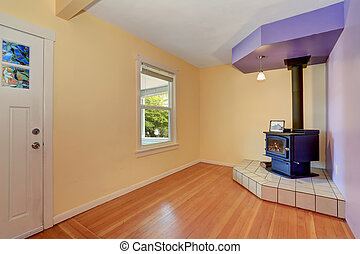 Empty entrance room with Vintage fireplace in the corner