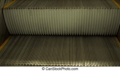 Empty escalator stairs in shopping mall