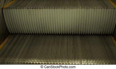 Empty escalator stairs
