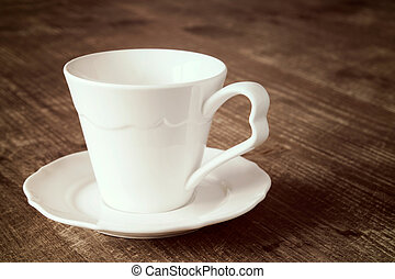 Empty espresso cup with a saucer