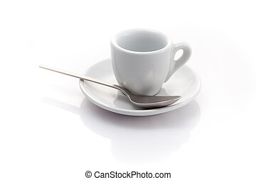 empty espresso cup with a spoon isolated on a white background