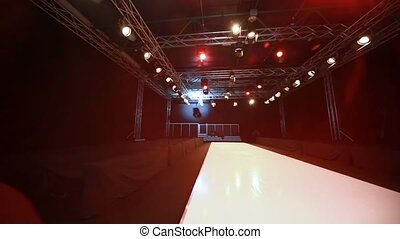 empty fashion model podium and lighting equipment, panning
