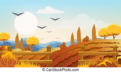 Empty fields surrounded by fences, bushes and trees. Autumn thematics. Flying birds