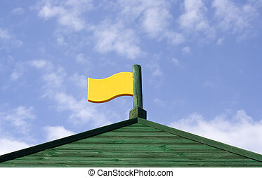 Empty flag on top of wooden fort roof