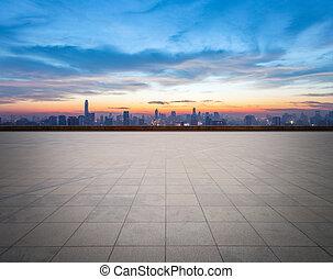 empty floor with city skyline