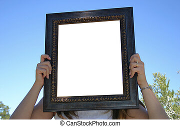 Empty Frame - A young woman holding up and an empty frame. ...