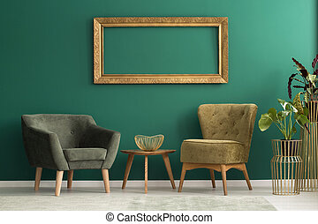 Empty frame above retro chairs