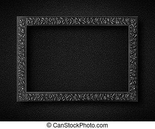 Empty frame on black wall.