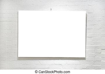 Empty frame on white brick wall