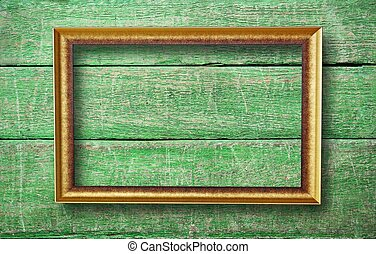 empty frame with copyspace hanging on creative green wooden background