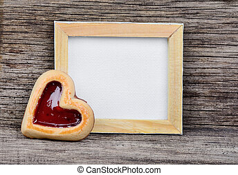 Empty frame with heart cookie