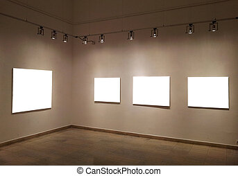Empty frames on gallery wall
