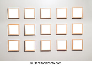 Empty Frames on the wall in modern art museum Gallery Exhibit Bl