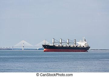 Empty Freighter with Suspension Bridge Beyond