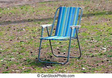 Empty garden chair on grass
