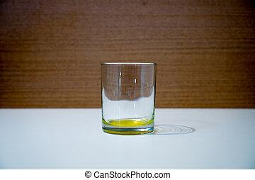 Empty glass beaker on the white table