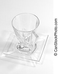 glass cup on a plate