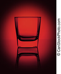 Empty glass for water, whiskey, juice or other drink on a rich dark red gradient background.