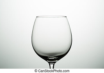 Empty glass for wine on gray background