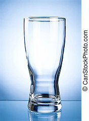 Empty glass glass for drinks on a blue background