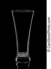 Empty glass isolated on black background.