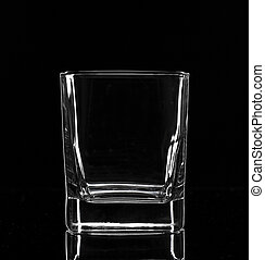 Empty glass, isolated on black background