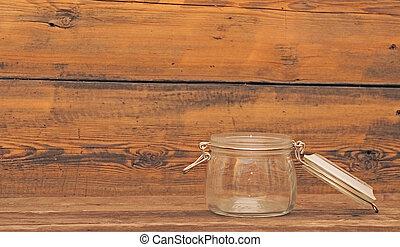 empty glass jar on wooden background