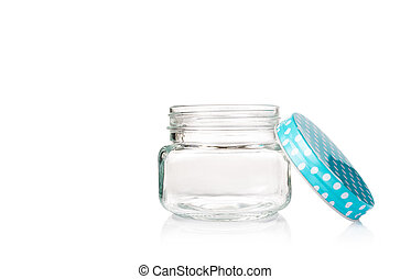 empty glass jar with opened blue dotted lid on white background, copyspace on top