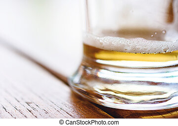 Empty Glass Of Cold Beer With Foam On Wooden Table