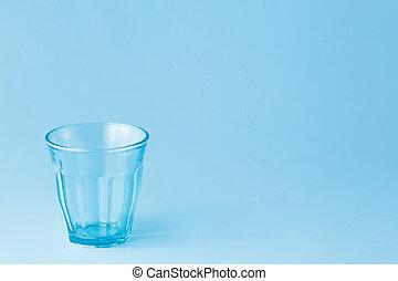 Empty glass on a blue background