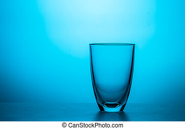 Empty glass on blue background