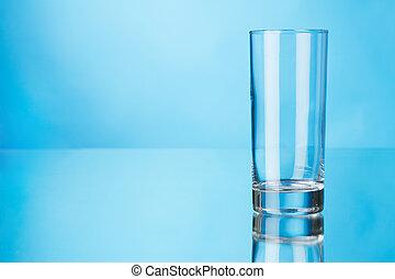Empty glass on blue background