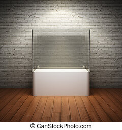 Empty glass showcase for exhibit in interior room with brick wall and spotlight