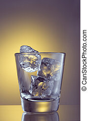 Empty glass with ice cubes