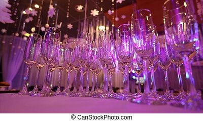 Empty glasses for champagne on the buffet table in the restaurant hall, buffet table, restaurant interior, glasses for champagne