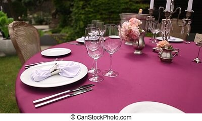Empty glasses for wine and water set on a festive table in a restaurant focus shift of glassware. Table decoration