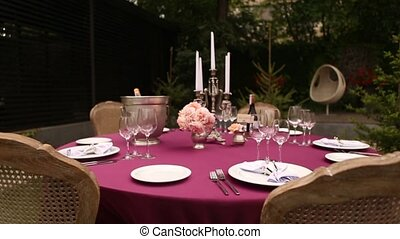Empty glasses for wine and water set on a festive table in a...
