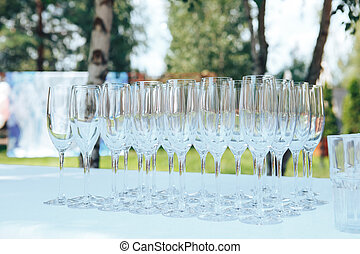 empty glasses on the white table. champagne glasses