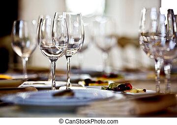 Empty glasses set in restaurant. Part of interior
