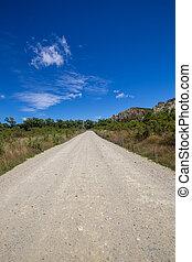 empty gravel road in new zealand
