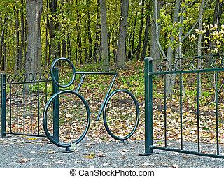 green metal bicycle rack