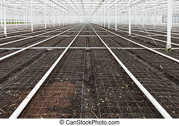 Empty greenhouse with soil prepared for cultivation of plants
