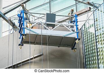 Empty hanging scaffold on a building wall - Empty scaffold...