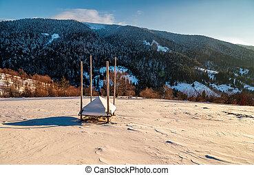 empty haystack shed on snowy hillside. beautiful winter...