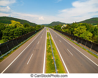 Empty highway on sunny day